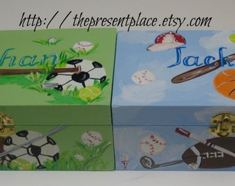 A pair of hand painted sports themed boxes in blue and green for  ring bearers gift personalized with a thank you note