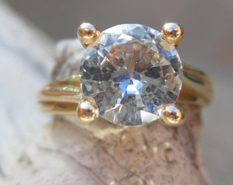Vintage Round Brilliant Solitaire Engagement Ring with a Colorless Synthetic Spinel in 10K Yellow Gold.