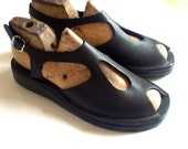 Handmade wedge sandal with peep toe and crepe sole by designer Emily Spray