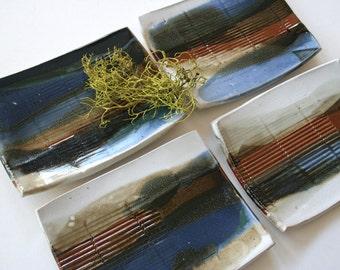 Set of four rectangular stoneware plates. Contemporary, Asian, appetizers, sushi, soap dish, blue, brown, celadon, white., texture.