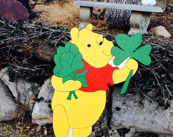 Winnie the Pooh holding a shamrock yard art, decoration