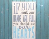 If you think our hands are full you should see our hearts Distressed Sign in Cream Vintage Style