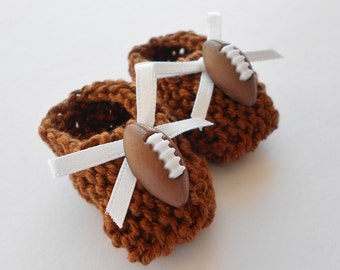 American football baby shower decorations: hand knit mini booties - 2 inches with football buttons and white bows