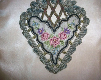 Very special metal applique with silk pettipoint antique
