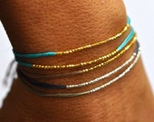 Gold beads on Turquoise silk friendship bracelet. Silk bracelet. Modern bracelet.