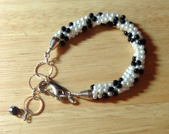 """Black and White Pearl Hand Beaded Kumihimo Bracelet Adjustable from 6.25"""" to 8"""" Wrist, One of a Kind, Previously 37 Dollars CLOSEOUT SALE"""