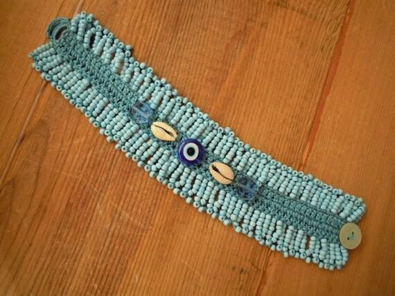 turquoise crochet bracelet with evil eye bead