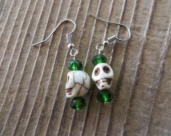 Dangling White Skulls And Green Crystal Earrings