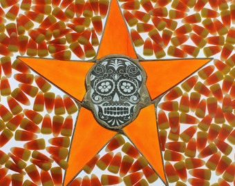 Dia de los Difuntos- 9.5 inch stained glass star with 3 inch skull center, Dia de los Difuntos or Day of the Dead- Orange stained glass