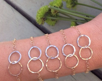 Infinity bracelet. Gold & silver interlocking rings. Wedding jewelry, friendship bracelets. Rings of love bracelet