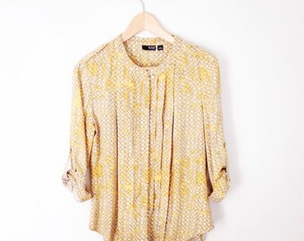 Yellow patterened blouse