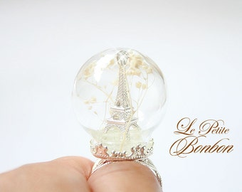Eiffel Tower in a glass globe winter wonderland edition ring