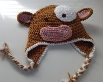 Cow earflap hat, crochet, brown and white, braids