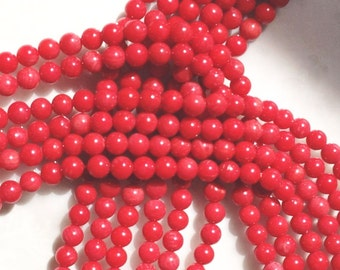 1 Dull  Red Coral smooth round beads strand.16.5 inches long