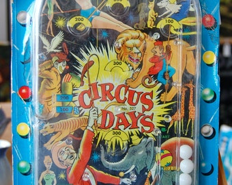 Vintage marble game. Circus Days.