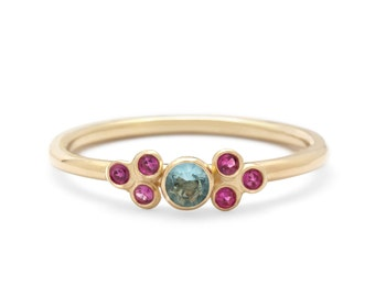 Polished Thin Blue Topaz Rubies Band Ring in 14k Yellow Gold