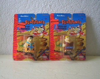 Two Flintstone Wind up Figurines, Fred and Barney.  In original packages. Boley, 1994
