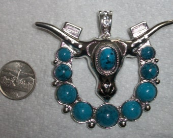 large western turquoise  longhorn in horse shoe pendant