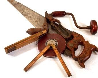 Henry Disston Saw, Tin Snips, Stanly Boxwood Folding Ruler, 72 inch Zig Zag Ruler, Hand Brace Drill, 100ft Favorite Wyteface Tape Measure