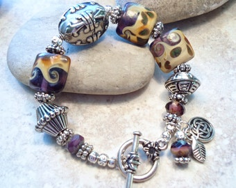 Swirled Lampwork Glass Beads and Textured Silver Bracelet