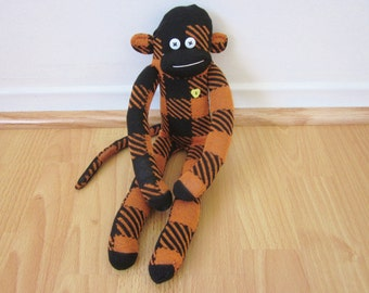 Orange patchwork sock monkey doll - orange and black checkered pattern