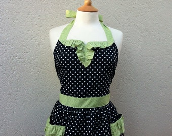 Retro 1950s vintage inspired apron with curved ruffle, white polka dot on black fabric.