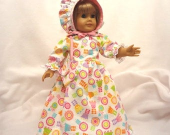 Spring floral print on white long Easter dress for 18 inch dolls, with white lace trim.