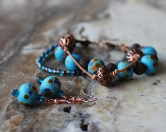turquoise lampwork crystal leather and copper bracelet and earring set
