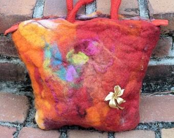 Beautiful red hand-made wool felt handbag.