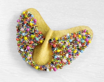 Heart shaped brooch with colorful glass sewn beads