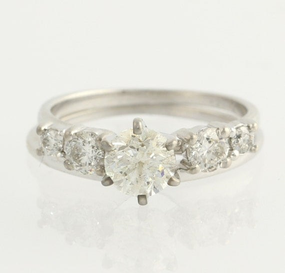 solitaire engagement ring enhancer by wilsonbrothers