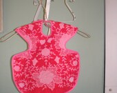 red and pink floral terry cloth bib
