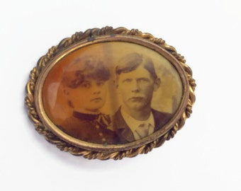 Til death do us part antique photo brooch old west style man and wife haunted eyes