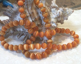 Orange cats eye bead - (6 mm round beads)- full strand