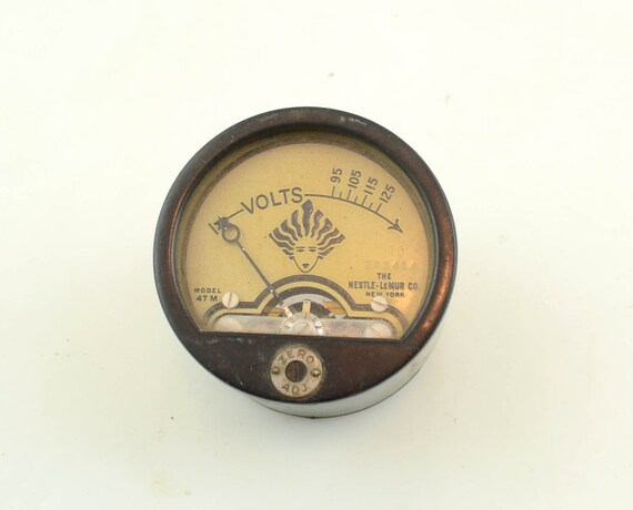 Antique Volt Meter : Strange antique volt meter with interesting graphics the