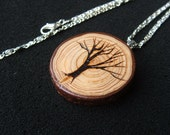 A Natural Larch Tree branch Pendant necklace. Embellished with A Tree.