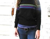 vintage black ski sweater. rainbow band. size small. acrylic with wool.