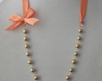 Gold Pearl and Coral Ribbon Bow Necklace