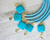 Stabilized turquoise on Blue Leather Cord Bracelet by pardes israel