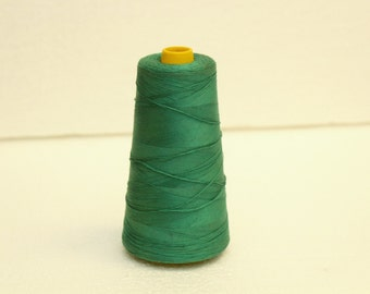 Large spool of vintage green sewing thread