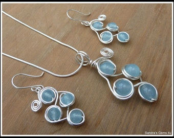 Aquamarine Pendant, wire wrapped in Silver, with chain.Matching Earrings available. March birthstone