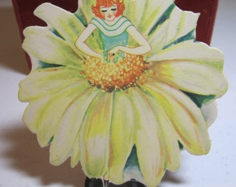 Gorgeous die cut unused Buzza colorful bridge tally card pretty redhead lady with a dress that looks like a daisy