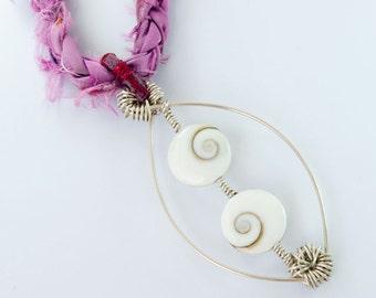 Oval pendant necklace , Cat eye shell , raw silk plait , lucky charm , infinity symbol , purple , operculum , black , swirl , one of a kind