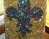 Hand Made FLEUR-DE-LIS Mosaic Design made with Mardi Gras Beads glued to a Cloth Canvas in the traditional colors of Green, Gold and Purple