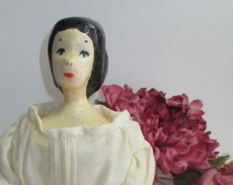 Folk art doll hand carved wooden doll with cloth body vintage from the 1970s