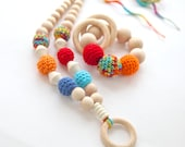 Bright colorful wooden teether set of 2. Teething ring toy and nursing necklace. Multicolor rattle for baby and mom.
