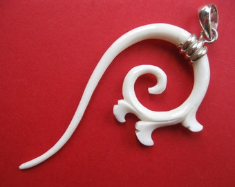 Tribal hand-carved BONE and sterling silver pendant.  Maori inspired awesomeness.
