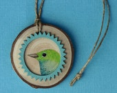 Watercolor bird on birch wood slice with frame, blue and green, painting, turquoise, round, natural, ornament