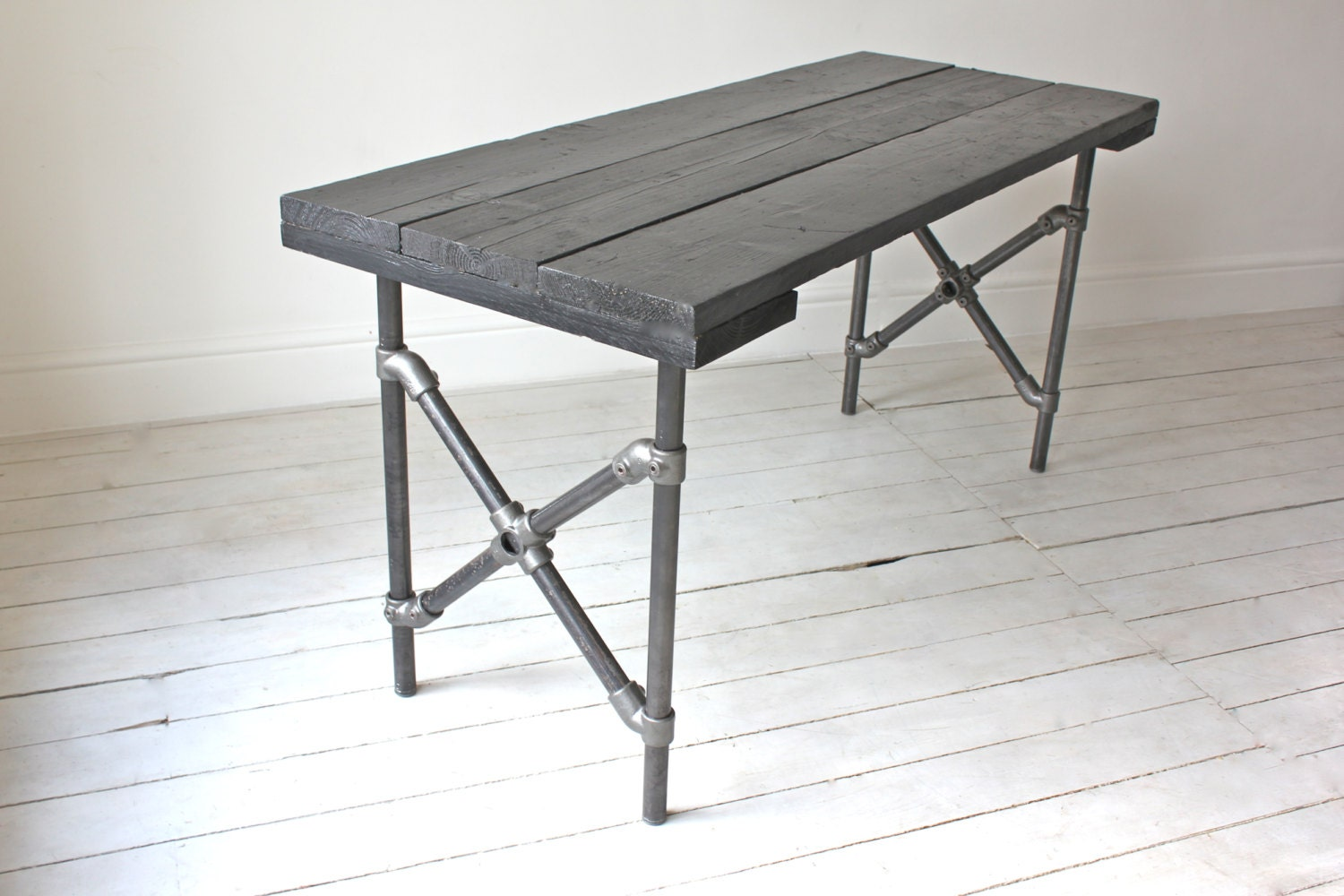 Reclaimed Scaffolding Board Painted Black With Criss Cross Dark Steel Legged Pipe Dining Table