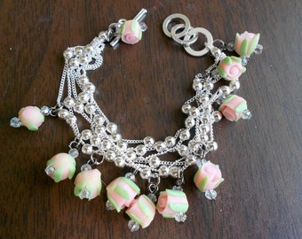 Pale pink/peach polymer rosettes on a silver beaded bracelet with toggle clasp.